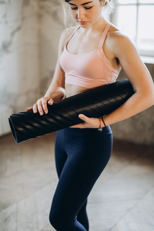 Woman Holding her Yoga Mat