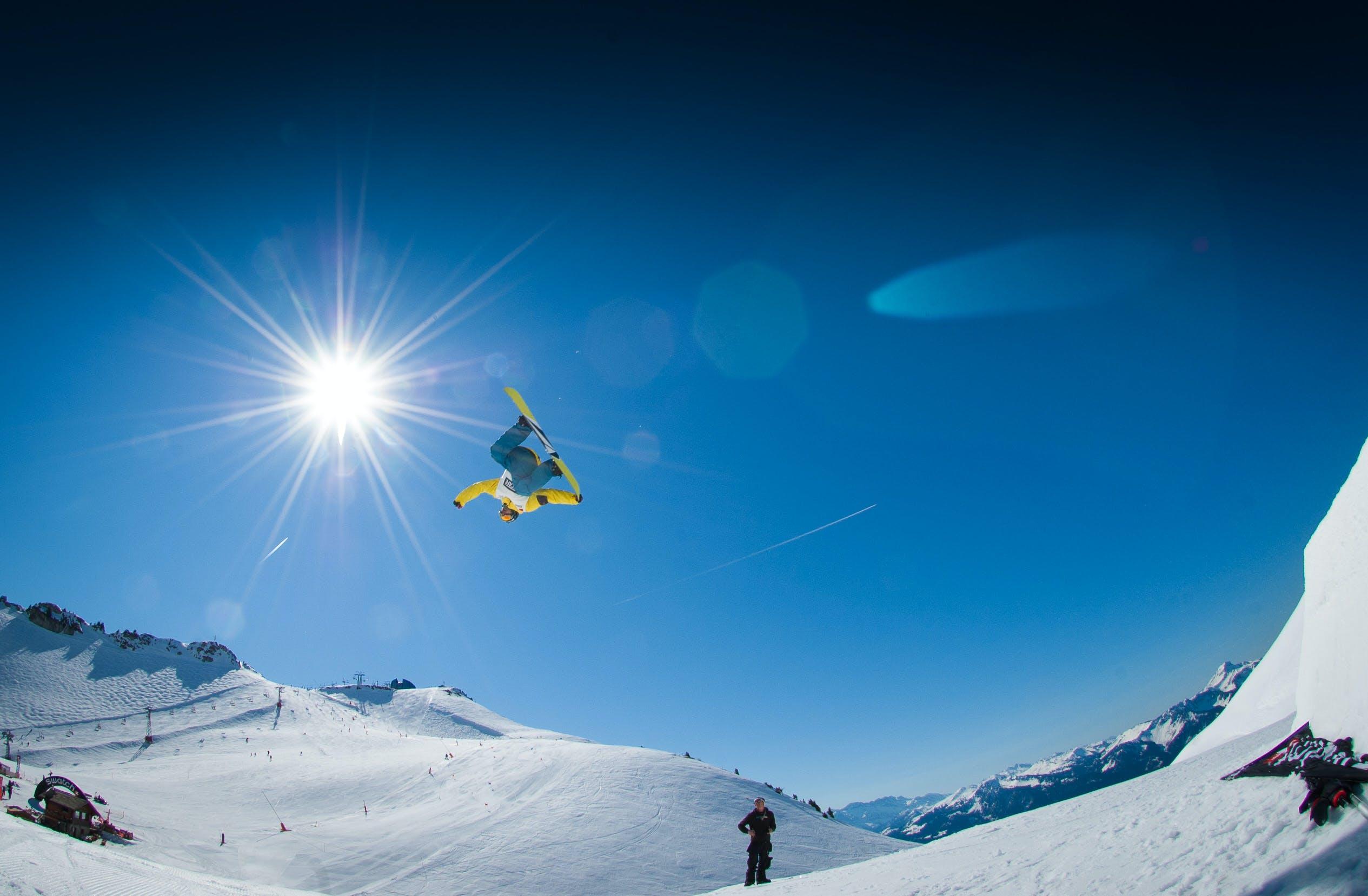 Man Performing Snowboard Stunts