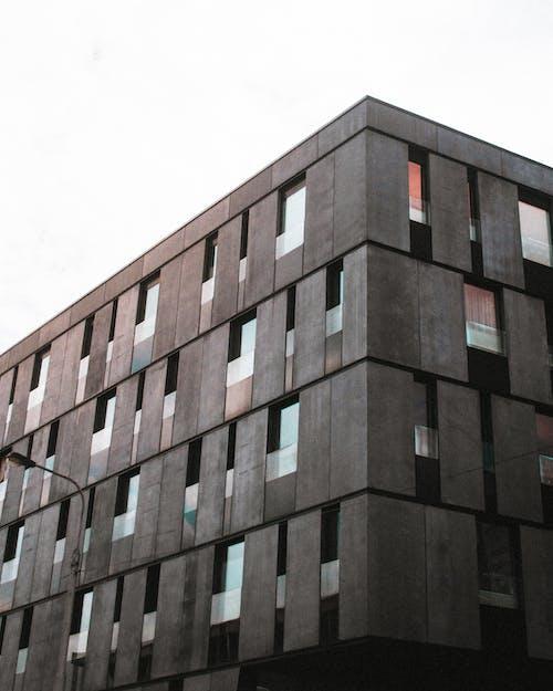 Brown Concrete Building Under White Sky