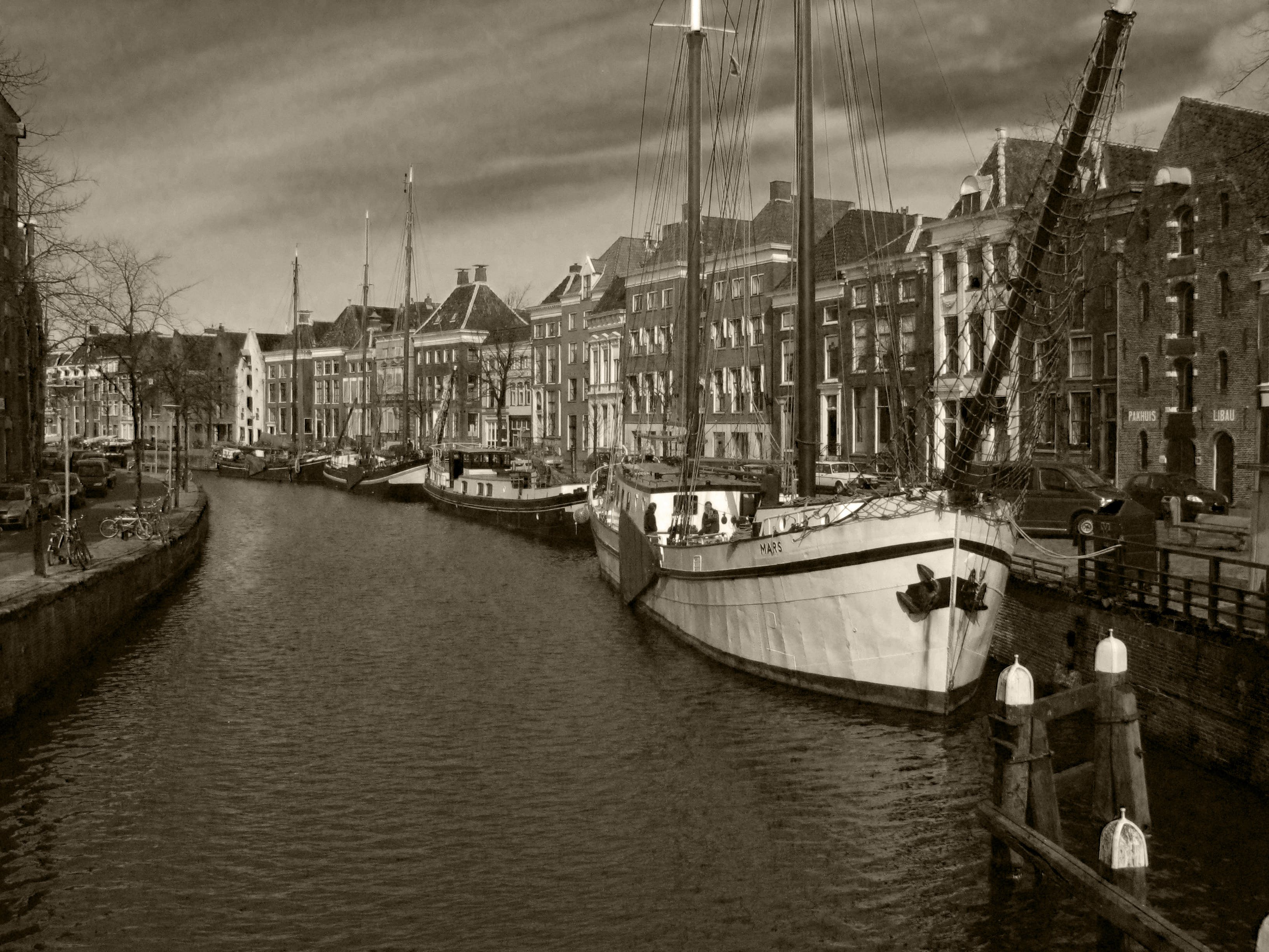 Grayscale Photography of Boats Near Buildings