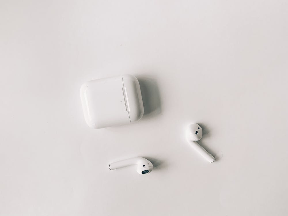 White Apple Airpods on White Table