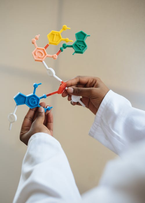 Crop chemist holding in hands molecule model