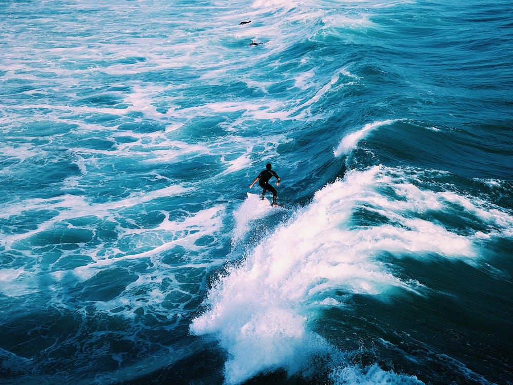Man Surfing on Ocean Sea Waves