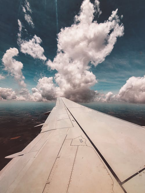 Free stock photo of above clouds, airplane, airplane wing, clouds