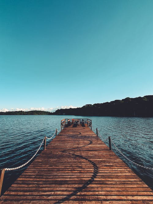 Brown Wooden Dock on Sea