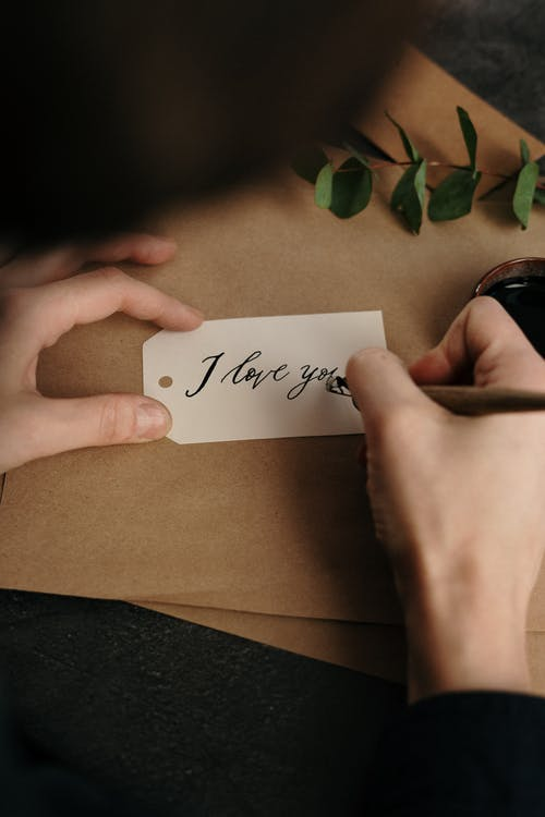 White Printer Paper With I Love You Written On It
