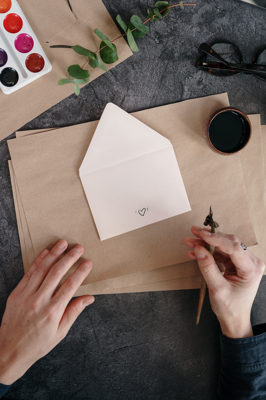 white printer paper on brown cardboard
