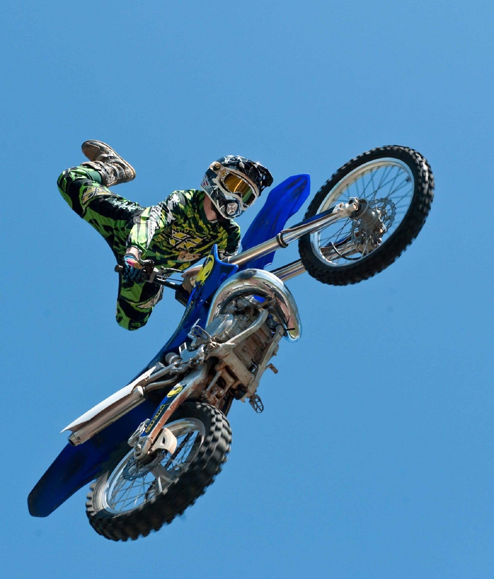 Man Riding Blue Dirt Bike