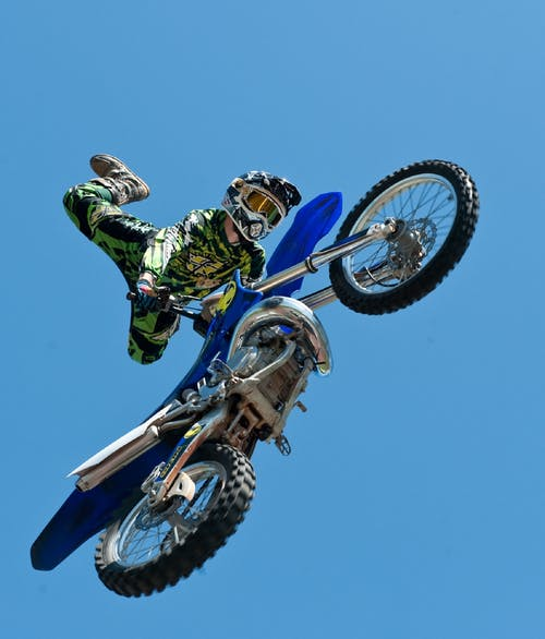 Man Riding Blue Dirt Bike