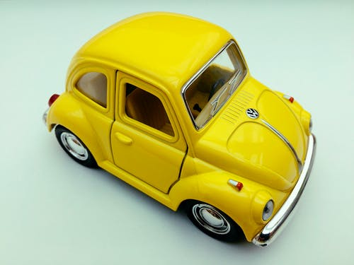 Yellow Volkswagen Beetle Toy Car on White Background