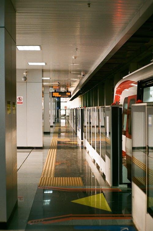 Empty train station platform with screen doors