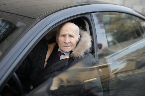 Man in Black Jacket Sitting Inside Car