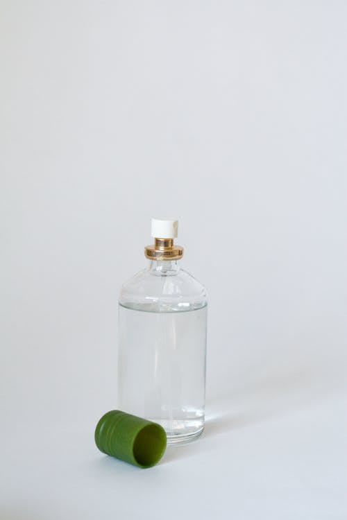 Clear Glass Bottle With Green Cap
