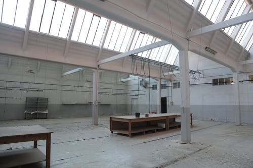 Modern interior of spacious empty warehouse