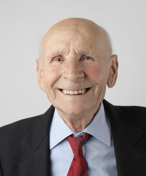 Elderly Man in Black Suit Jacket Smiling
