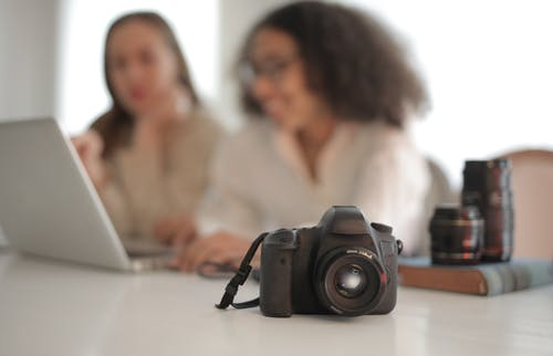 Professional photo camera on table in bright room