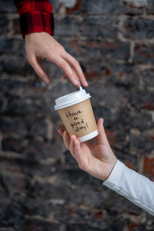 Person Holding A Paper Cup