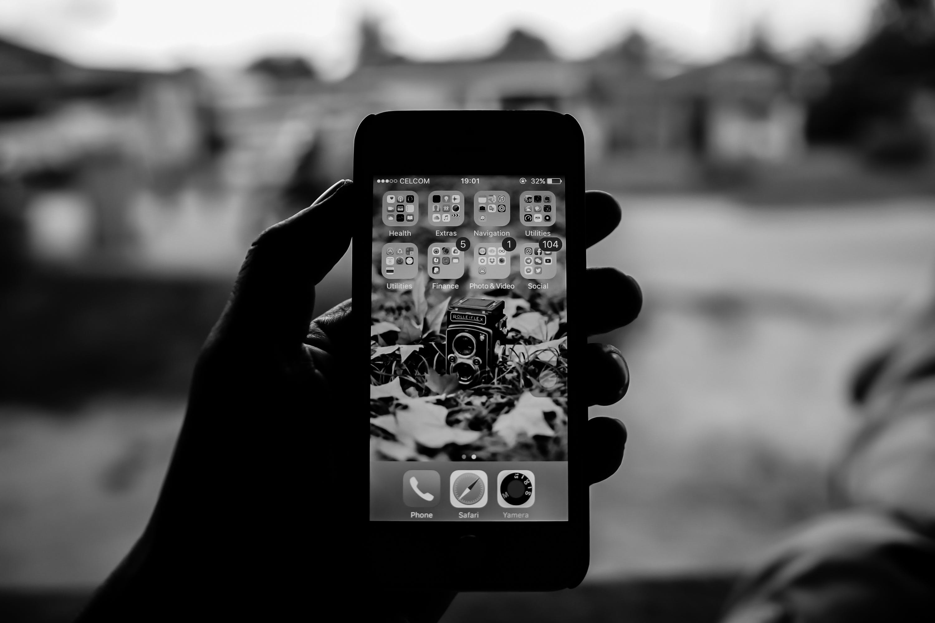 Grayscale Person Holding Smartphone