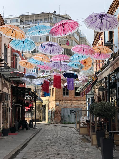 Colorful umbrellas decorating street of old city