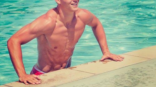 Man Standing Beside Swimming Pool