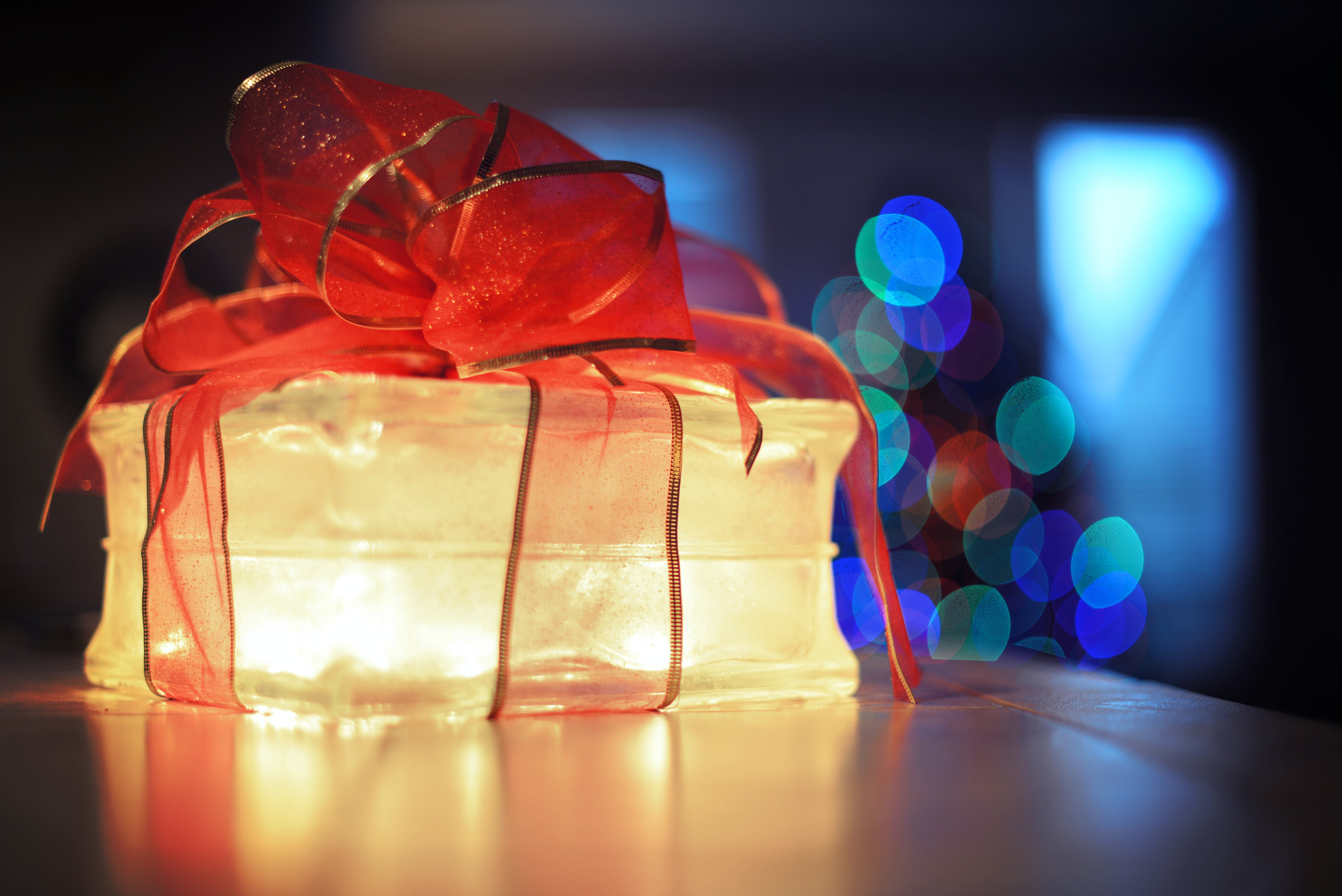 Lighted Gift Box on Brown Surface