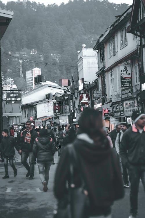 Free stock photo of black and white, christmas market, citizens, city life