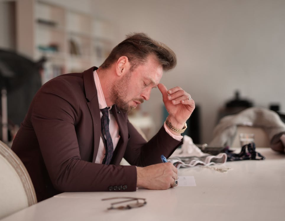 Focused businessman taking notes at home