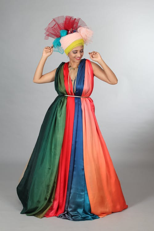 Woman in Colorful Sleeveless Dress