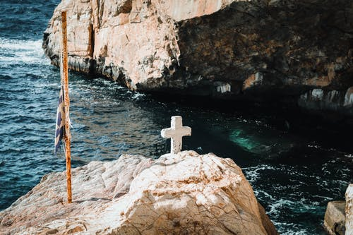 White Cross On Rock Formation