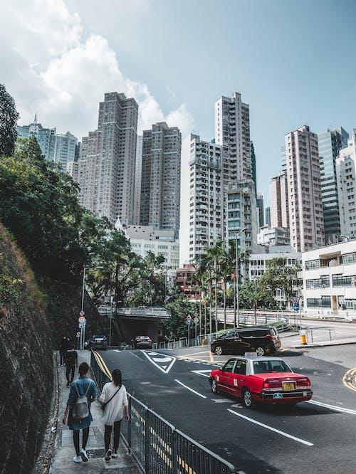 Asphalt road near modern tall buildings in city district