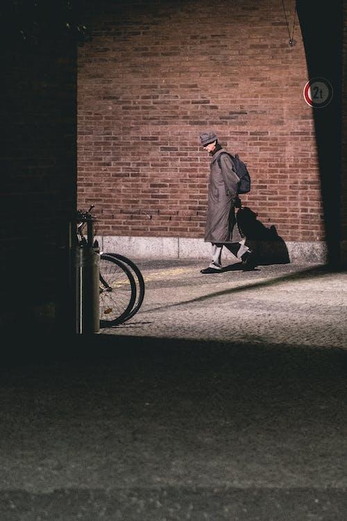 Elegant man walking on street in city district