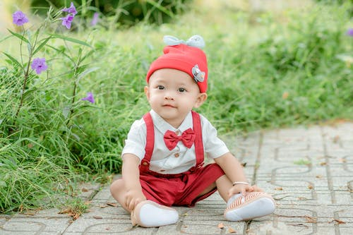 Cute toddler in red hat