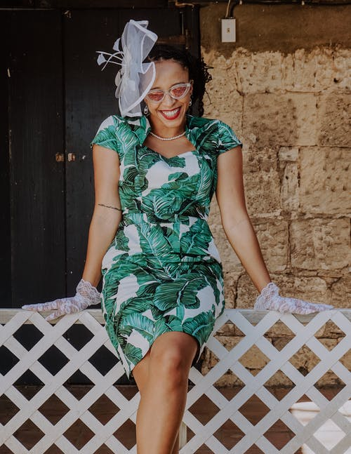 Woman in Green and White Floral Dress Wearing White Floral Headdress