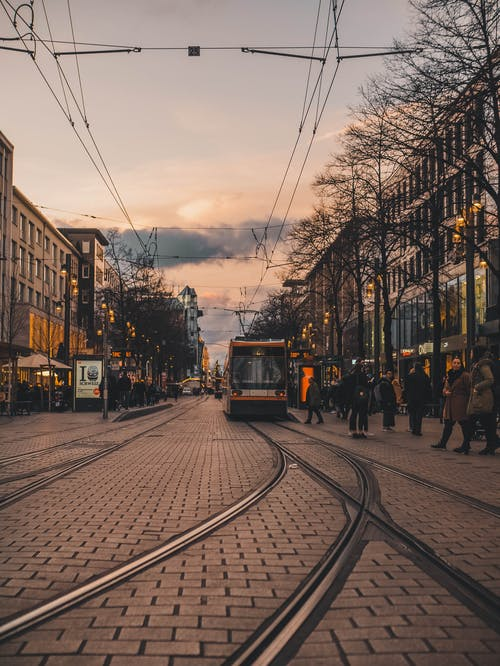 City tramway on paved street in sunset
