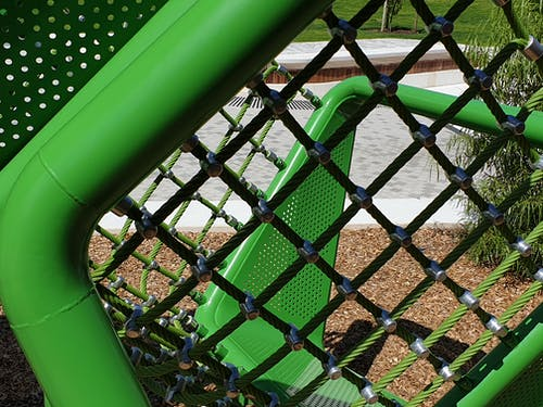 Free stock photo of architectural design, green, netting, park equipment