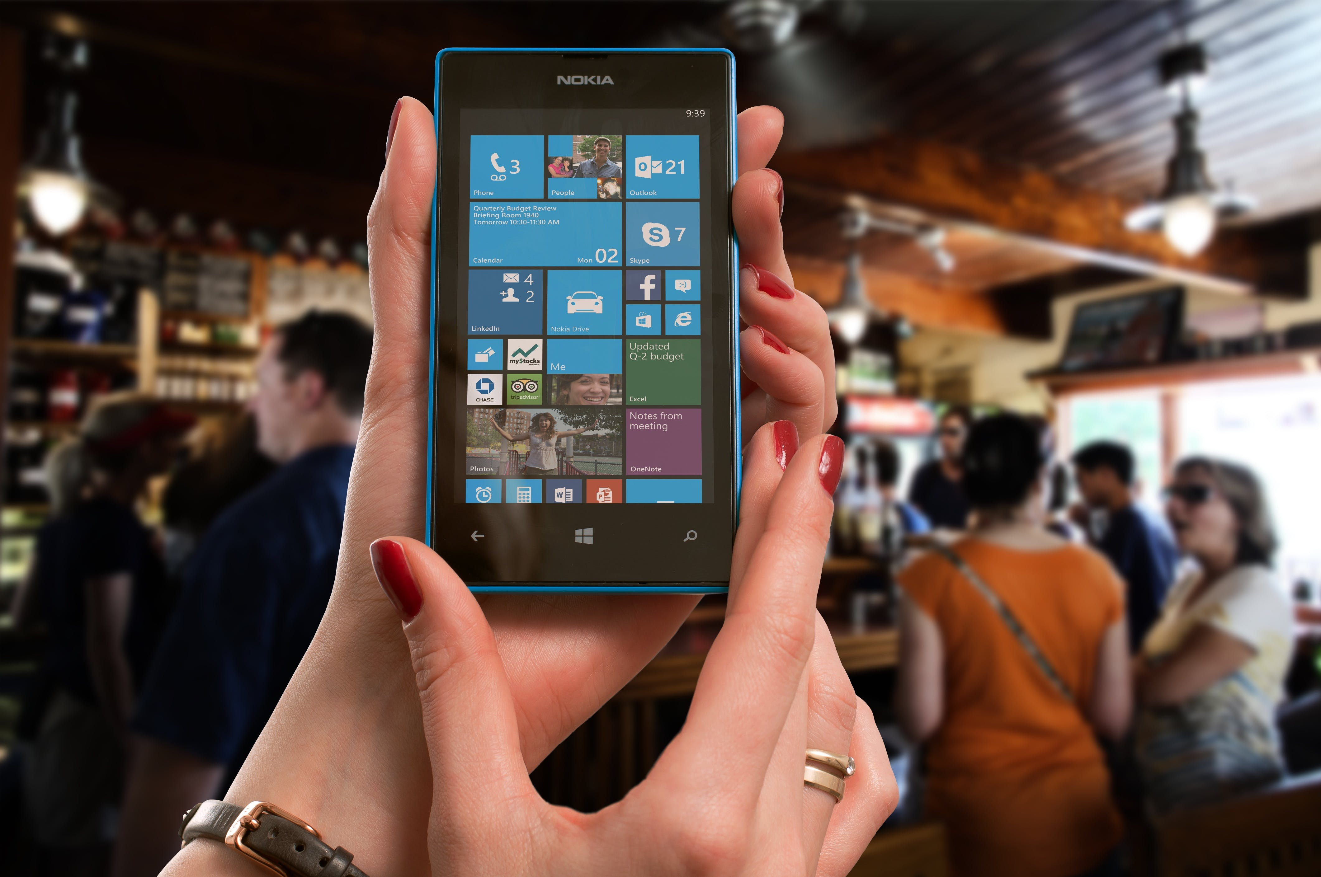 Woman Wearing Gold Ring Holding Blue Nokia Windows Smartphone