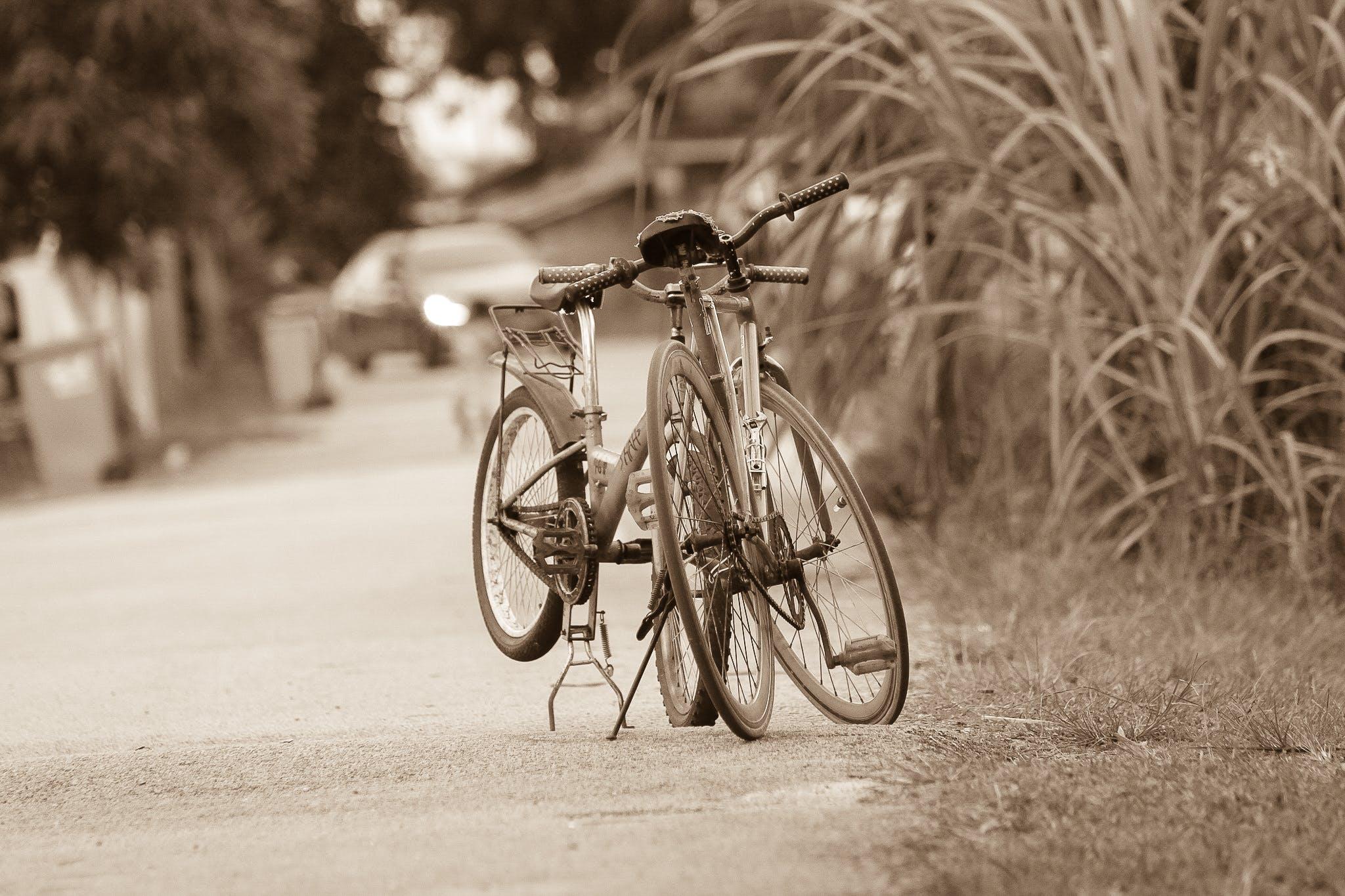 Grayscale Photo of Rigid Bikes