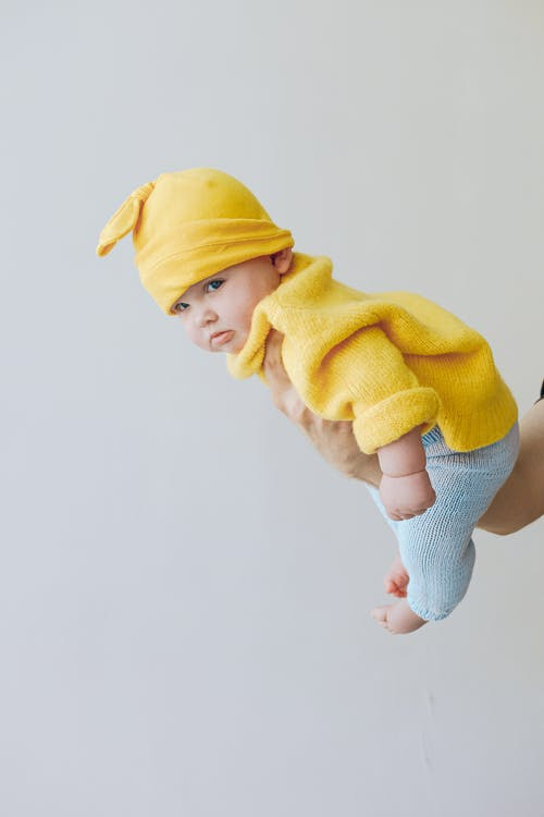 Child in Yellow Knit Cap and Yellow Sweater