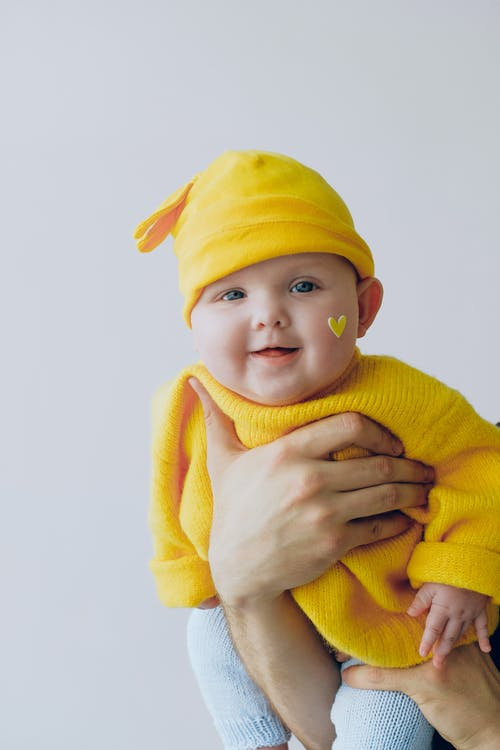 Baby in Yellow Knit Sweater