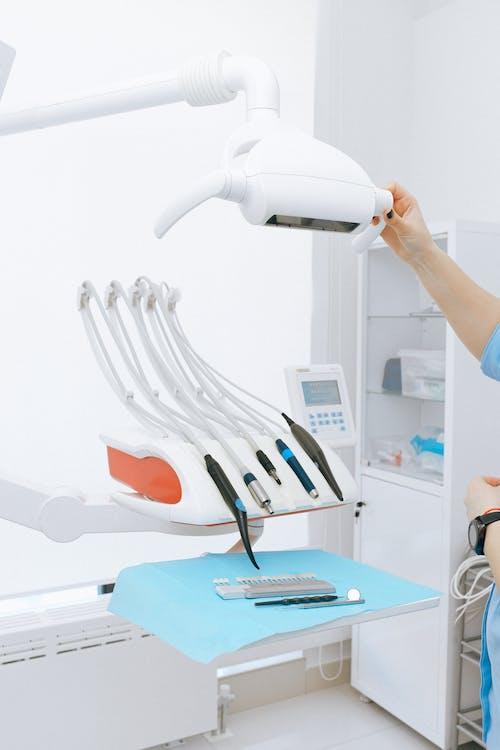 Modern dental equipment on table in light room in clinic