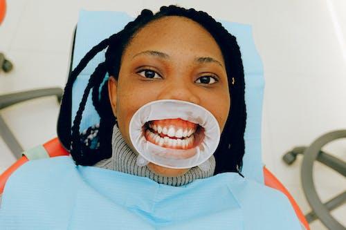 Woman with Dental Cheek Retractor