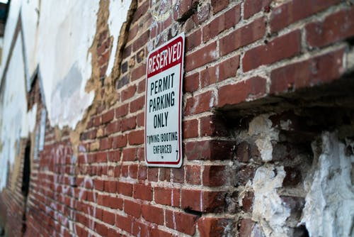 Free stock photo of brick wall, city photography, citylife, parking area