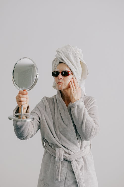 Woman in Gray Bathrobe Wearing Black Sunglasses