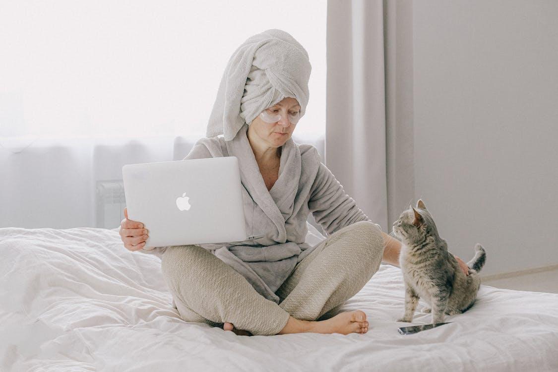 Woman in Gray Bathrobe Using Macbook