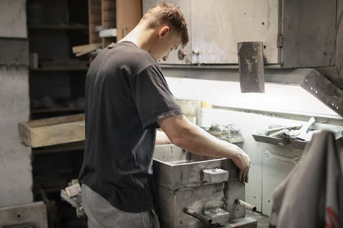 Young worker making detail in workshop