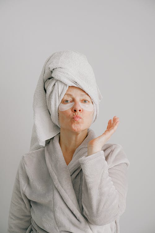 Woman in Gray Bathrobe Pouting