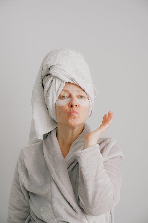 Woman in Gray Bathrobe Pouting