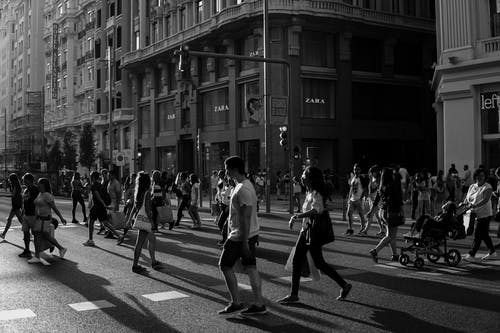 People Walking on Street in Grayscale Photography