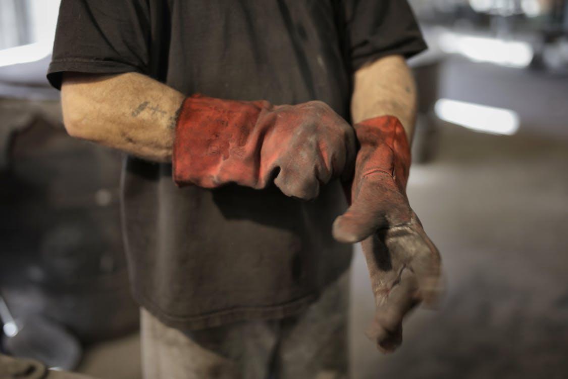 Anonymous worker in heavy duty gloves