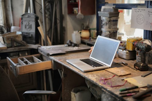 Laptop on table in workshop